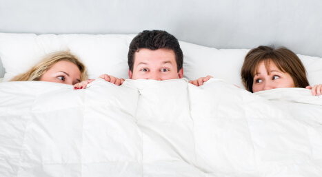 man lying with two girls
